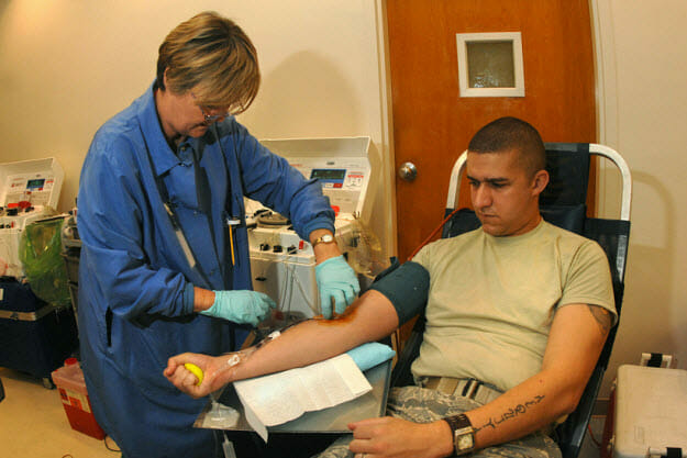 Desperate ways to earn extra money: Man donating plasma.