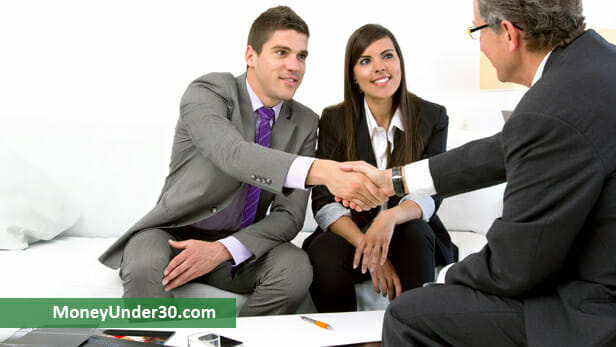 Stock photo of a young couple meeting with their financial adviser. Via MoneyUnder30.com