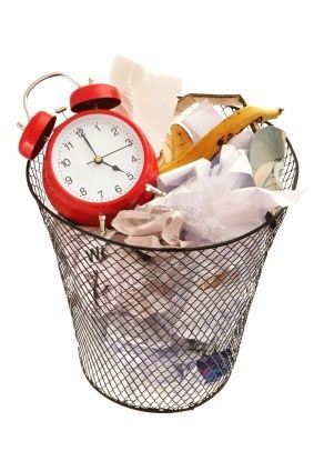 Wasting Time: Clock in Trash Can